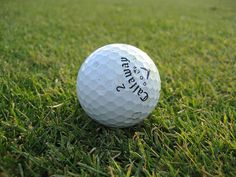 artsy close-up of a golf ball     Tips on how to get or improve your(golf clubs,golf equipment,golf bags,golf shoes,golf courses,online golf stores,golf swing,golf pictures,golf players,golf balls,golf)***Like to improve your Golf take action and follow this link for more info*** htt