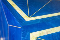 Detail of mitred corner with mother of pearl border, satin wood stringing and blue dyed veneer, from luxury credenza