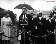 Arrival ceremonies for the King and Queen of Afghanistan on the South Lawn, 5 September 1963. Pictured includes: Eunice Kennedy Shriver; President Kennedy; Dean Rusk (Secretary of State); and King Mohammed Zahir. (