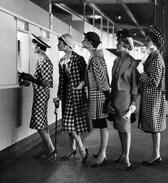 """Five models wearing fashionable dress suits at a race track betting window, at Roosevelt Raceway. Photographed for LIFE Magazine, 1958."""