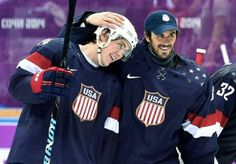 TJ Oshie and Ryan Miller after Team USA's 3-2 shootout win over Team Russia.