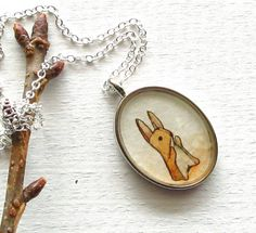 Rabbit necklace. Couldn't decide which board to put this on, but I do want it very much.