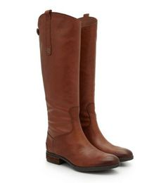 Sam Edelman's classic leather riding boot, Penny, adds luxe equestrian chic to any outfit with its sleek, timeless silhouette. This universally-flattering style features a pull-on tab and back zipper
