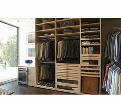 A simple design, ample storage options, and natural light make this walk-in closet design easy to use and functional. Design by http://laclosetdesign.com/