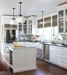 Vary Light Fixtures ~ Choose pricier, eye-catching fixtures to highlight one or two main areas in the kitchen, such as the island or sink. Opt for less-expensive, off-the-shelf fixtures elsewhere.