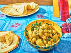 "This savory, herbal Trinidadian chickpea-and-potato curry is an island adaptation of a common north Indian dish. It comes from the Trini cooking teacher Dolly Sirju, who dislikes comparisons of Trinidadian food to Indian. ""India is totally different than Trinidad,"" she says. This dish swaps out tomatoes, ginger and whole spices for Madras curry powder and waves of cilantro-like flavor. Serve it with steamed white rice or roti flatbread. (Photo: Grant Cornett for The New York Times)"