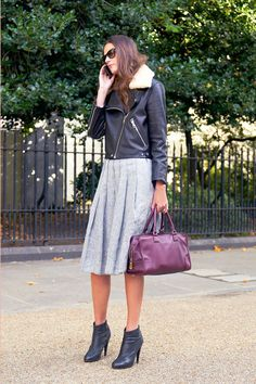 A knee-length pleated skirt goes the extra mile with biker-chic edge.   - ELLE.com