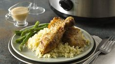 Slow-cooked chicken, browned and served with a creamy roasted garlic sauce, makes a comforting meal and is great served with couscous.