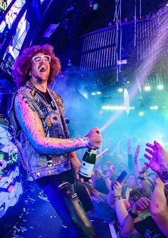 Marquee Celebrates Five Years with Party Rock Monday (Pictured: Redfoo Sprays Champagne – Photo credit: Al Powers).