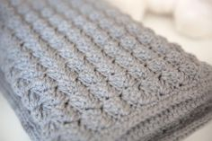 """Quick and Thick Beginner Baby Blanket. """"This pattern is a quick and easy one. I used an extremely soft merino/acrylic blend since babies have very sensitive skin. If you use a different yarn from what my pattern calls for, make sure that its machine washable since it will definitely be going through the wash many times."""" Crochet Hook: K/10.5 or 6.5 mm hook Yarn Weight: (5) Bulky/Chunky (12-15 stitches for 4 inches)"""