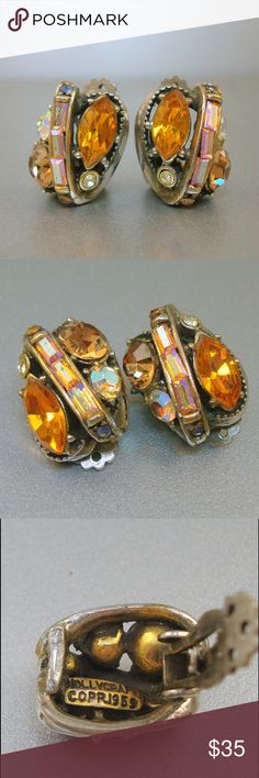 """Vintage Hollycraft Orange Rhinestone Earrings Vintage Hollycraft clip on earrings with orange, amber and aurora borealis rhinestones set in silver tone metal. The earrings measure 3/4"""" and are signed """"Hollycraft, Copyright 1959"""". Hollycraft jewelry is highly sought after by collectors for its design, craftsmanship and use of color. Hollycraft Jewelry Earrings"""