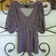 Flattering Bell Sleeve Blouse Retro purple pattern featured on this stylish babydoll styled blouse. Bell sleeves and back tie detail makes this shirt super chic and flattering. Size XS gently worn Banana Republic Tops Blouses
