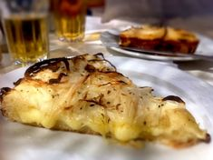Fugazzeta, a pizza exploding with onions and mozzarella on a thick crust, is one of the many Italian influenced dishes that is commonly found in Argentina. Honest Cooking