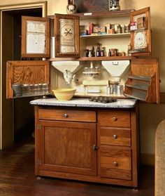 The Hoosier Highboy Cabinet combined all of the prevailing trends of the Arts & Crafts period. It was organized, efficient and hygienic with cleverly designed storage and easily cleaned, sanitary work surfaces. In many early period kitchens, this was all the cabinetry there was. This Hoosier, complete with pull-out Porceliron work surface and zinc bins, is located at Castle Tucker in Wicasset, Maine, an 1807 house preserved to illustrate a late 19th century upper middle class home.