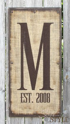 Monogram on burlap with letter and marriage year. @Maria Henderson Pesterfield (I can so do this... :))