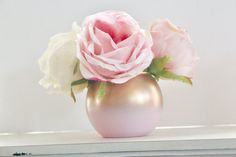This beauty is perfect for your event.  The combination of pink and gold ombre never disappoint.  This piece is perfect with a few flowers or simply filled with some babys breath.  We also offer coordinating mason jars : https://www.etsy.com/listing/269046547/pink-and-gold-ombre-mason-jars-gender?ref=shop_home_feat_1   The dimensions are 3.5 inches in height with a 3 inch mouth opening. Flowers are NOT included.   Disclaimers:  These may be filled with water for...