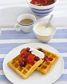 This rendition of a breakfast favorite owes its substantial crunch to yellow cornmeal and its subtle tang to buttermilk. Warm, syrupy nectar from the fruit compote seeps into the waffles for a touch of sweetness. A dollop of creme fraiche blended with confectioners' sugar adds another layer of texture and taste.