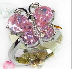 'Sizes 6/7/8/9 Pink Butterfly Lab Created ring' is going up for auction at  3pm Wed, Aug 28 with a starting bid of $12.