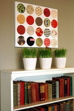 Love this simple idea of creating art from circles cut from construction paper.