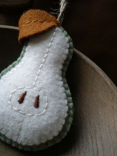 Wool pear that inspired wool pear appliques on our son's baby blanket.