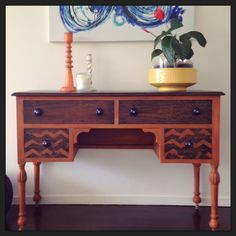 Up-cycled dresser in burnt orange and dark wax. Royal blue handles. Restored and hand painted at www.onebeautifulthing.com.au