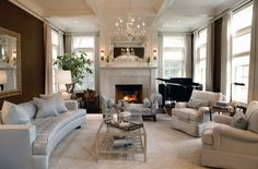 love the mirror over the fireplace and sconces