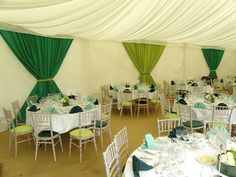 Green drapes, limed chiavari chairs with green seat pads and green napkins to match corporate client brand colours by www.stressfreehire.com #venuetransformers