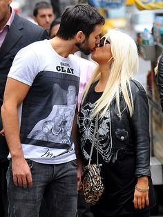 CHRISTINA & MATTHEW  Now that's multitasking! Christina Aguilera manages to walk and kiss at the same time, getting a smooch from boyfriend Matthew Rutler while walking in New York City on May 14.