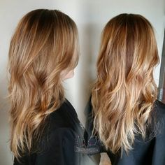 Blonde balayage highlights and a rich auburn base long layers with waves