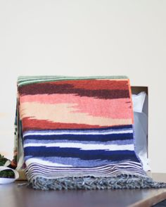Today in #25PerfectGifts: For the homebody, an ultra-luxe throw from Missoni Home plays double duty: functional for chilly nights with a wool/cashmere blend, and a dynamic pop of color when not in use.
