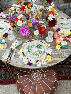 The Jam Event// Woodstock inspired tablescape, bohemian daisy flower crowns, marigolds, wooden beads and leather poufs // whimsical and rustic wedding inspo// Wild Heart Events