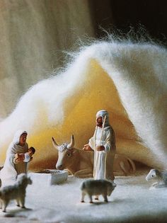 Nativity - the soft creche in the background! Great display idea.
