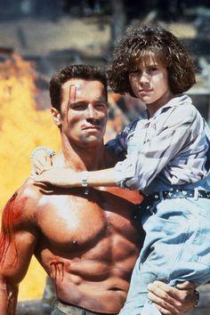 "Arnold Schwartzenegger and Alyssa Milano in ""Commando"" (1985)."