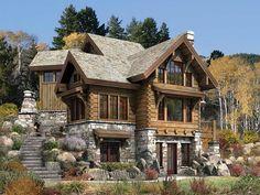 Casa rústica de madeira com base de pedra, no estilo americano