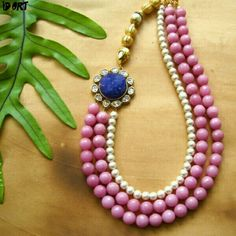 A Partywear Fashion Jewellery Necklace made using agates ,white beads and duzy side pendant. The necklace measures 11.5 inch ( but it comes with adjustable back cord ). This one comes with matching pair of earrings which measures 1 inch . 100% Genuine Product.