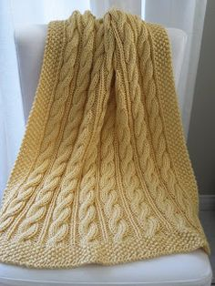 This blanket was my first cable project, and although it looks scary, it was actually easier than any lace pattern. The nice part about cabl...