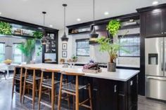 28 Modern Fish Tanks That Inspire Relaxation Modern Fish Tank, Stone Fireplace Designs, Modern Architects, Smart Kitchen, Houzz, Kitchen Trends, Glass House, Danish Design, Windows And Doors