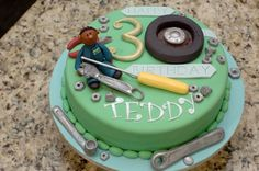 A birthday cake for a mechanic (who repairs buses).
