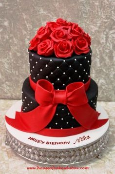 Black cake with red roses - CakesDecor