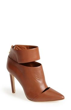 Free shipping and returns on BCBGeneration 'Carolyn' Cutout Suede Bootie (Women) at Nordstrom.com. A pointy-toe bootie is undeniably alluring with its peekaboo cutouts and slim, stiletto heel.