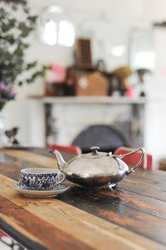 """The wooden kitchen counter is made of repurposed floor boards bought from Kabinett."" Source Design Sponge sneak peak Paula Mills  family"