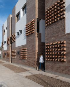 Affordable brick housing built for Argentinian teachers. Architects: Architecture Studios Nomada and Eypaa Spanish Architecture, Brick Architecture, Brick Detail, Low Cost Housing, Desert Homes, Space Interiors, Brick Patterns, Grand Designs, Facade Design