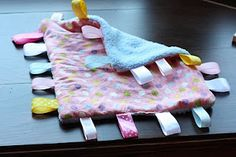 Ribbon/Tag blanket for baby.