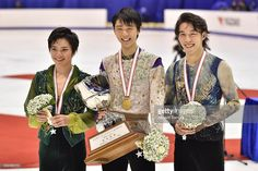 Shoma Uno (silver), Yuzuru Hanyu (gold) and Takahito Mura (bronze) of Japan pose with their medals during the day two of the 2015 Japan Figure Skating Championships at the Makomanai Ice Arena on December 26, 2015 in Sapporo, Japan.