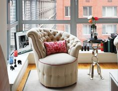 Love the unique shape of the chair and the pop of color with the piping against the neutral upholstery.