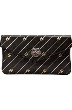 6b2a184e8542 $1,980 Broadway GG Archive-P Leather Envelope Clutch - GUCCI. Glimmering  feline-head hardware brings signature fierceness to the flap of a  vintage-inspired ...