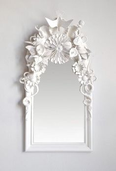 These beautifully sculpted mirrors are designed by the artists of Codor Designs, but with a little flea market hunting and gathering, you could probably DIY one of a similar look. With a splash of white spray paint, an old and dingy mirror — or frame — reflects calm and serenity. Ahhh.