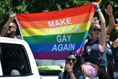 St. Louis Pride Parade Make America Gay Again Flag. LGBTQ  Pride, lesbian, gay, bisexual, transgender, queer. St. Louis, MO. Pride month. Rainbow flag.