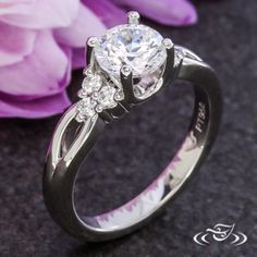 Platinum solitaire with accent cluster diamonds