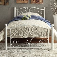 Found it at Wayfair - Pallina Wrought Ironl Bed  Also white flower decoration I like